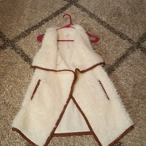 Fuzzy vest with faux leather trim